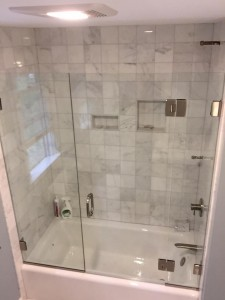 Custom Tub Enclosure With 2 Fixed Panels And Door Hinged Off Panel
